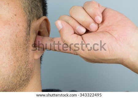 Man cover your ears with your fingers