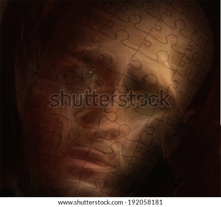Man covered in Puzzle skin displays worried expression - stock photo