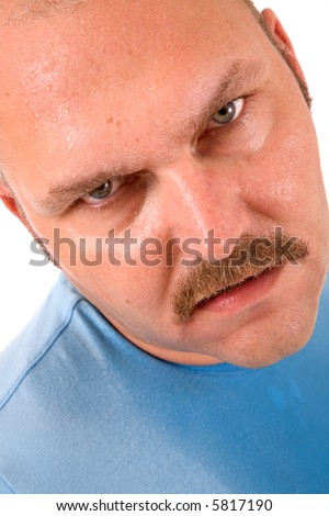 Man covered in sweat looking up with an unhappy face - stock photo