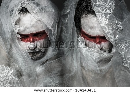 man covered with white lace veil, mask of red makeup - stock photo