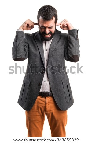 Man covering his ears - stock photo