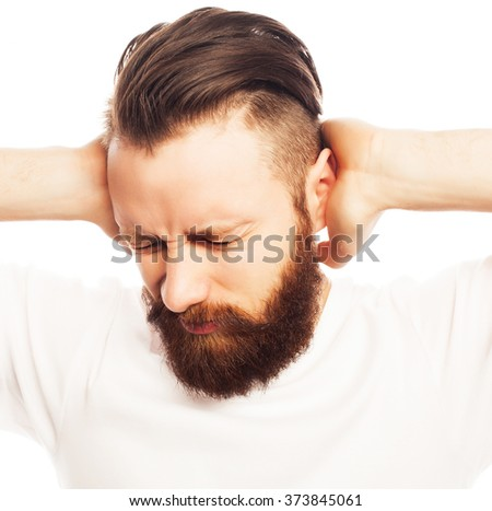 man covering his ears by hands