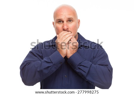 Man covering his mouth to speak no evil. Portrait of bald, handsome young man isolated on white background.  - stock photo