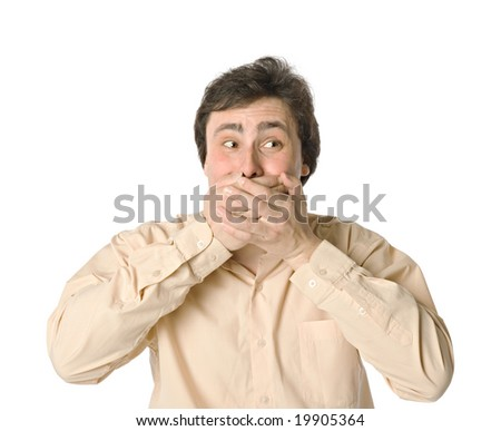 Man covering his mouth with hands, white background - stock photo