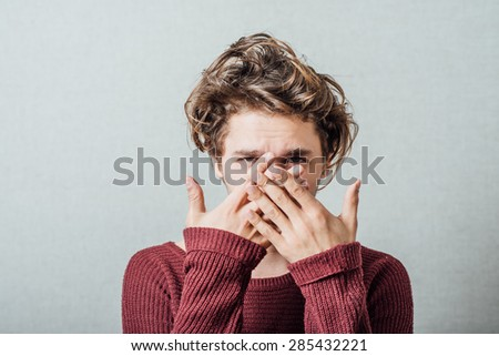 man covers his face - stock photo