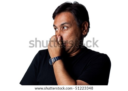 Man covers nose due to a bad smell. Studio image