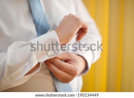 man cufflinks buttons on the sleeve shirts - stock photo