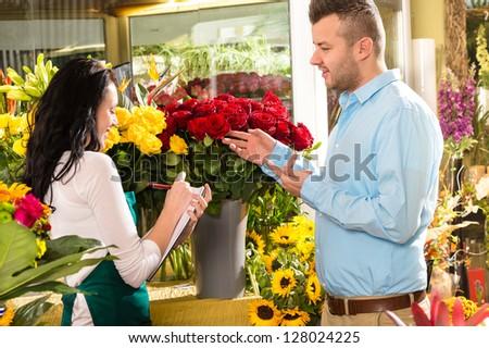 Man customer ordering flowers bouquet flower shop florist - stock photo
