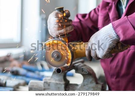 Man cut metal cutting wheel. - stock photo