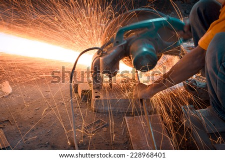 Man cutting and welding at work shop  - stock photo