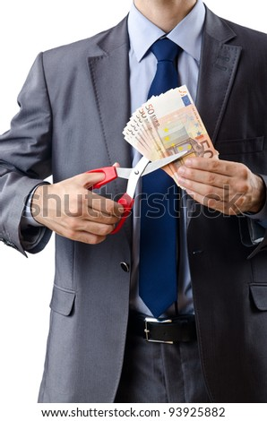 Man cutting money on white