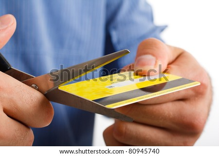 Man cutting up a credit card - stock photo