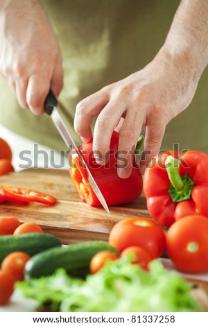 man cutting vegetables - stock photo