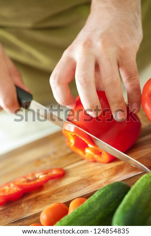 man cutting vegetables for salad - stock photo