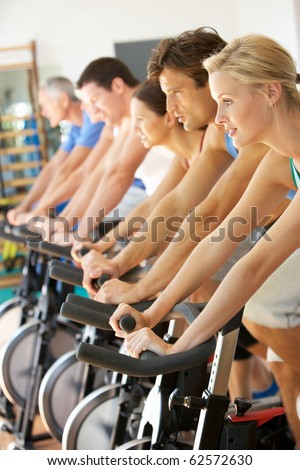 Man Cycling In Class In Gym