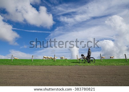 Man cycling on the North Sea Cycle Route in the Netherlands - stock photo
