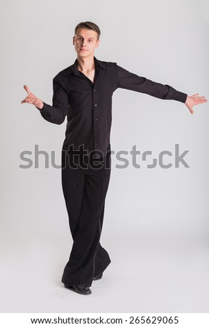 Man Dancer ballroom dancing. Portrait of a dancer on a light background. Sports, dancing, active, healthy lifestyle. - stock photo