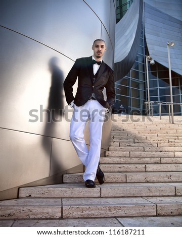 Man dancing down stairs - stock photo