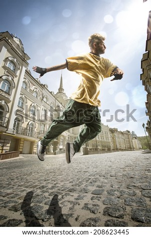 Man dancing Hip-hop in street - stock photo