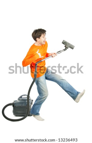 Man dancing with vacuum cleaner isolated over white background