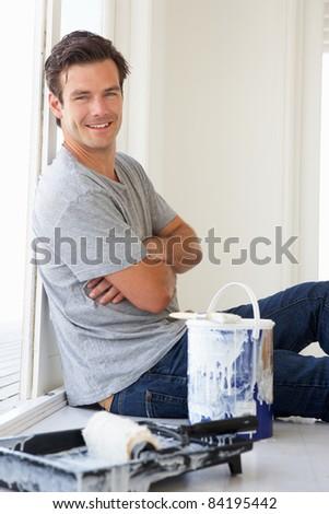 Man decorating house - stock photo