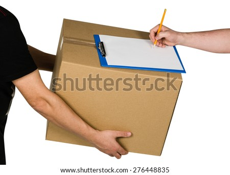 Man delivering a cardboard - stock photo