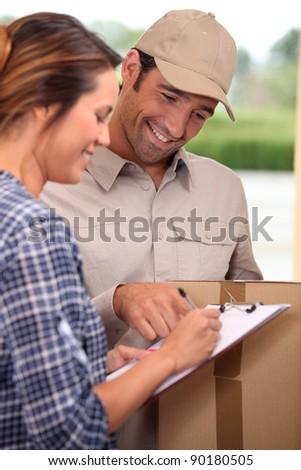 Man delivering parcel - stock photo