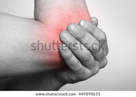 man demonstrated elbow pain
