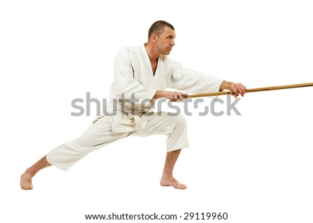 Man demonstrating martial arts isolated over white background