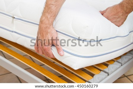 man demonstrating quality of mattress