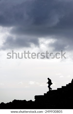 Man descending the falaise ofSan Sebastian de la Gomera, Canary Islands, Spain - stock photo