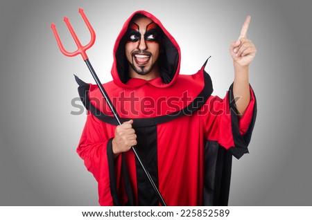 Man devil in red costume - stock photo