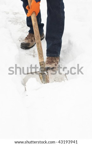 Man digging a path from the snow - stock photo