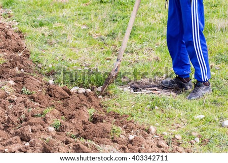 man digging the garden with a shovel