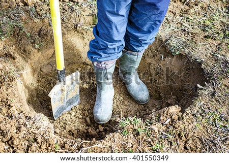 man digs a pit, shovel for digging the ground, digging the garden, a lot of sand, gardener and cultivation of land, digging a hole, the beginning of the gardening season