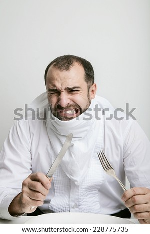 Man disgust sitting at the table - stock photo