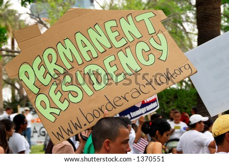 Man displaying sign urging immigration reform - stock photo