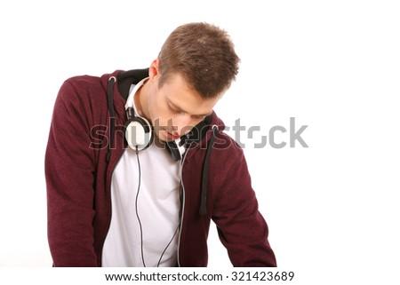 man dj with headphones isolated on white - stock photo