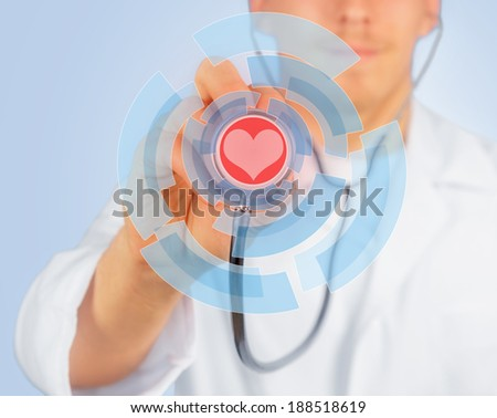 Man doctor listens with stethoscope, red heart is painted on stethoscope, concept of health - stock photo