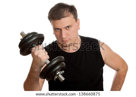 Man does exercise with a big dumbbell