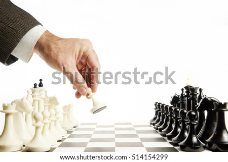 Man does first move in a chess game. Beginning of competition