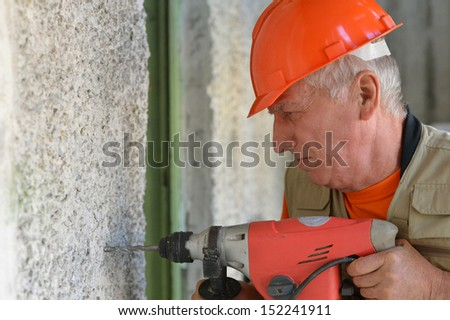 Man does the construction work with the punch - stock photo