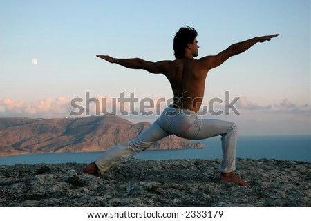 Man doing a virabhadrasana - stock photo