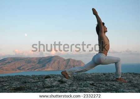 Man doing a virabhadrasana (variant) - stock photo