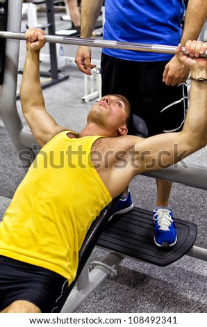 Man doing athlete exercise in fitness club