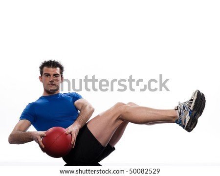 man doing ball abdominals workout posture on isolated white background - stock photo