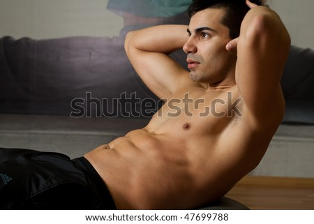 man doing exercise for belly.Fitness concept - stock photo