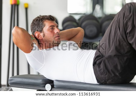 Man Doing Exercises for Abdominal - stock photo