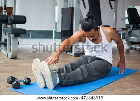 man doing exercises in fitness sport club