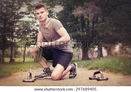 Man doing fitness outdoor, in the park.